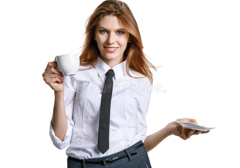 Coffee break. Photo of pretty businesswoman holding porcelain cup with coffee - isolated on white background royalty free stock photos