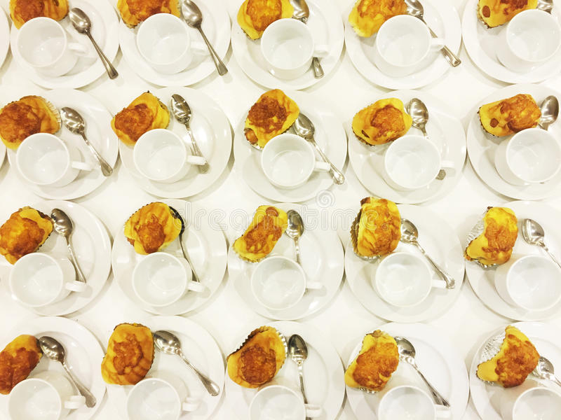 Coffee break. Top view bread and empty white coffee cups on the plate, preparing for a meeting break stock photos