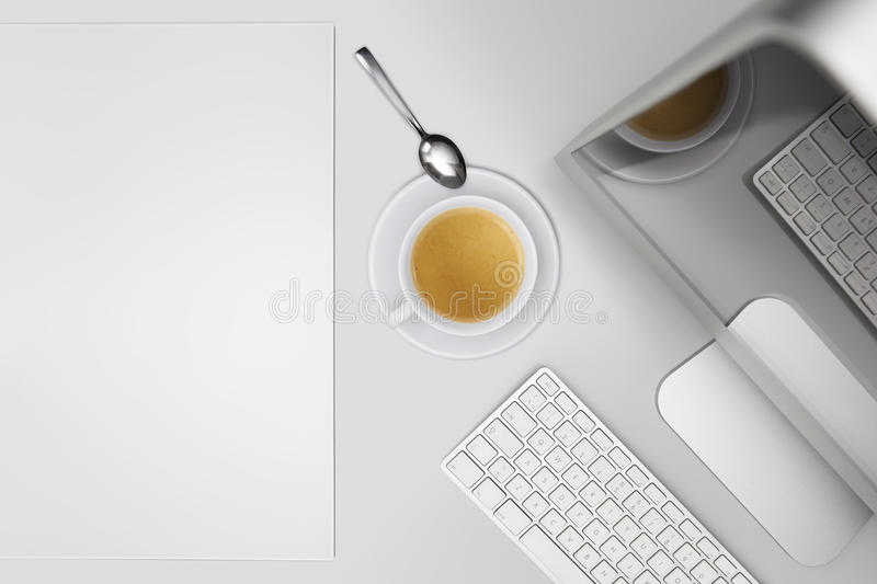 Coffee break, top view desk with computer and cup of coffee. With spoon royalty free stock photography