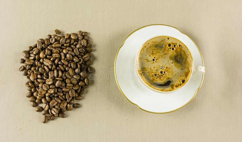 Coffee in a cup and in grain. stock photography