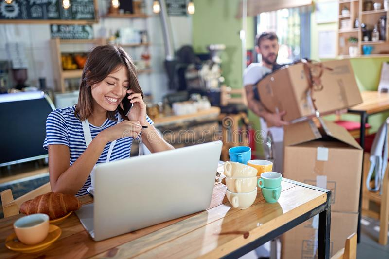 Coffee business concept - Girl owner working stock photography