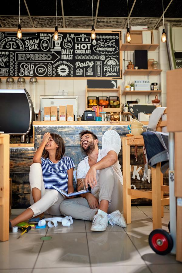 Coffee business concept.Happy business people working together at their cafe store stock images