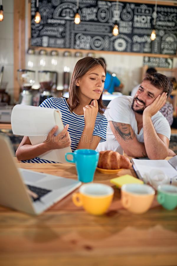 Coffee business concept.Young people work to open their cafe stock images
