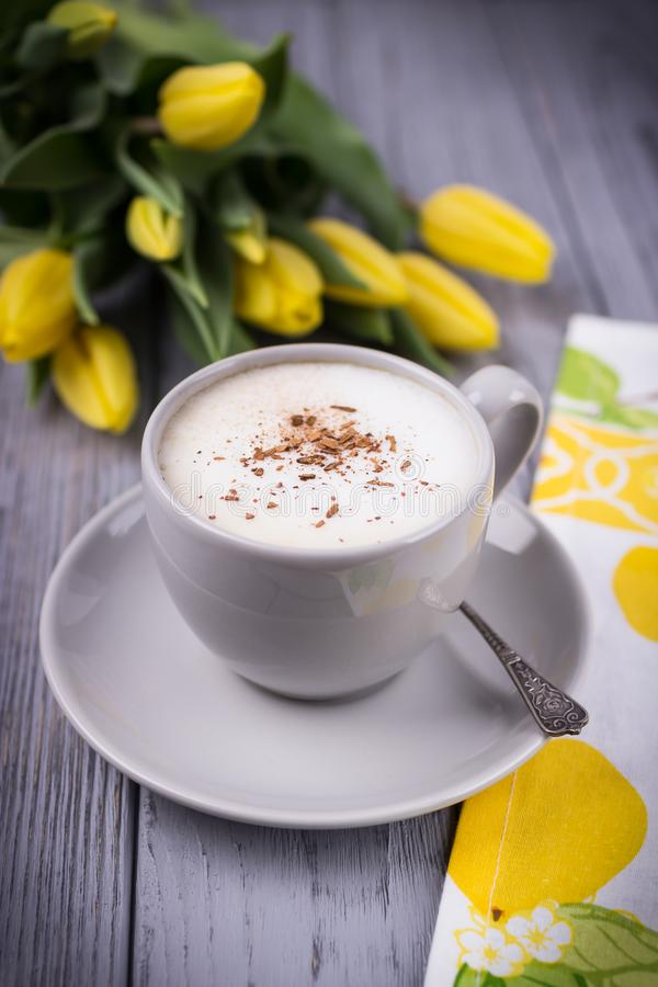 Free Coffee Cappuccino With Ceylon Cinnamon And Yellow Tulips On A Gray Background Stock Photo - 110463050