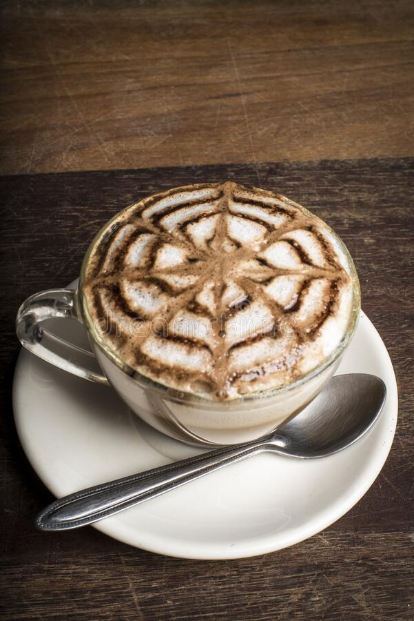Coffee cappuccino on a wood backgound royalty free stock photo