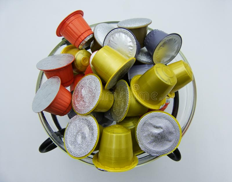 Coffee capsules for a coffee machine in a glass jar royalty free stock photos