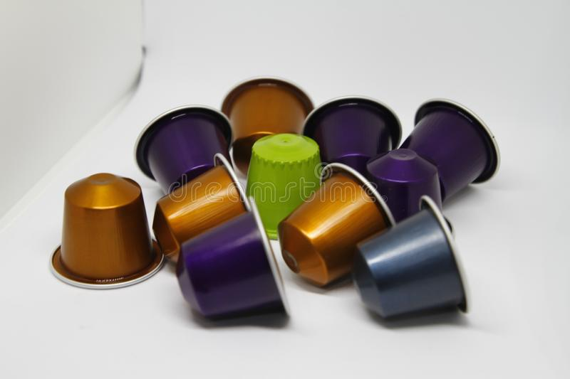 Coffee capsules on office desk royalty free stock image