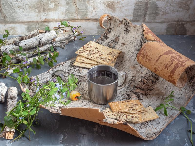 Coffee with cereal biscuits, a small birch bark picnic with wildflowers stock images