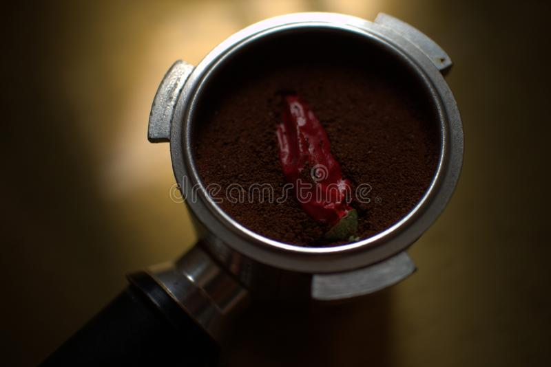 Coffee with chilly pepper stock photography