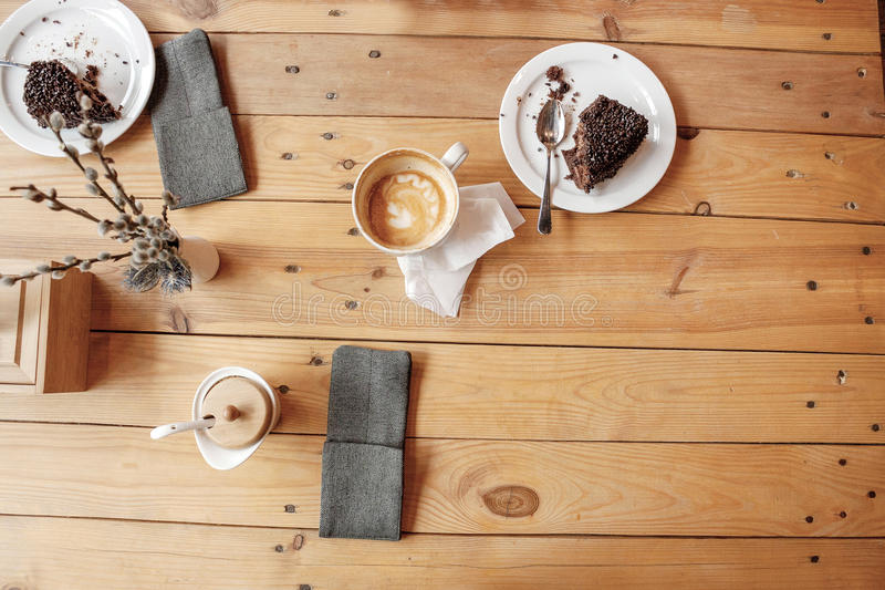 Coffee and chocolate cake for dessert on a wooden table. Image coffee and chocolate cake for dessert on a wooden table royalty free stock photo