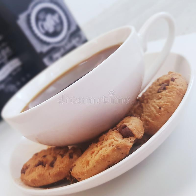 Coffee and chocolate chip cookies for having a good time royalty free stock photography