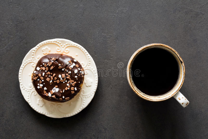 Coffee and chocolate donut stock image