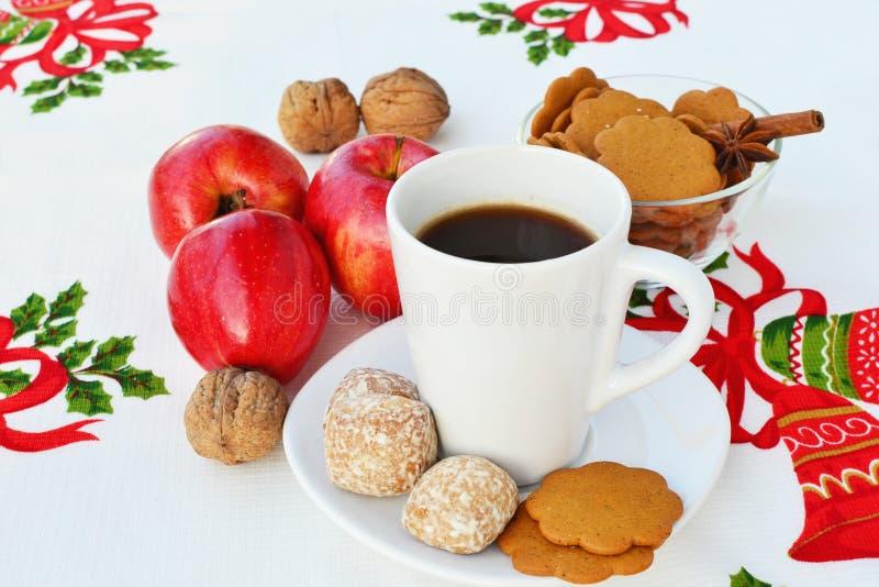 Coffee and Christmas goodies. Big cup of coffee and Christmas goodies stock photos
