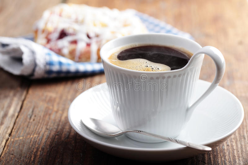 Coffee with cinnamon roll stock images
