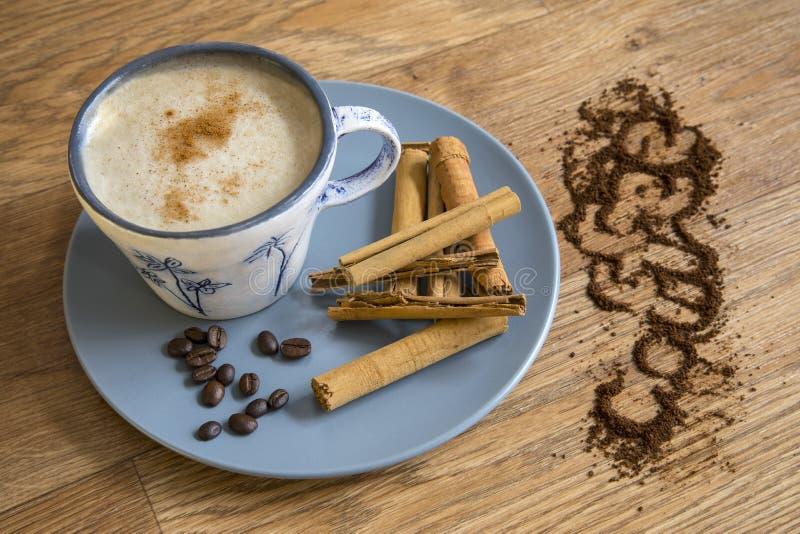 Coffee, roast beans and cinnamon sticks. royalty free stock photo