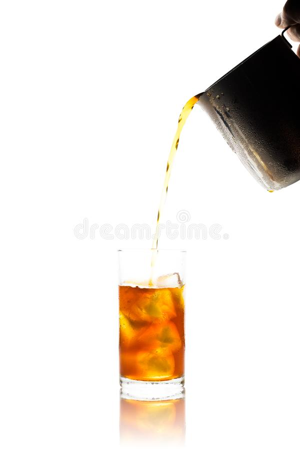 Coffee clod brew process (Method) by French press. Fill-pouring iced americano into a glass of water with iced. Isolated on white. Coffee clod brew process ( royalty free stock photo