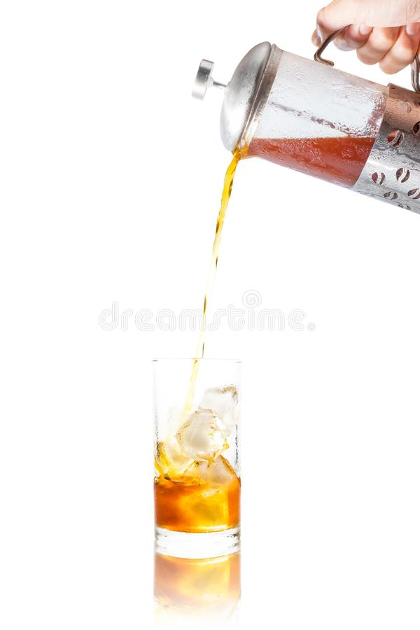 Coffee clod brew process (Method) by French press. Fill-pouring iced americano into a glass of water with iced. Isolated on white. Coffee clod brew process ( royalty free stock photos