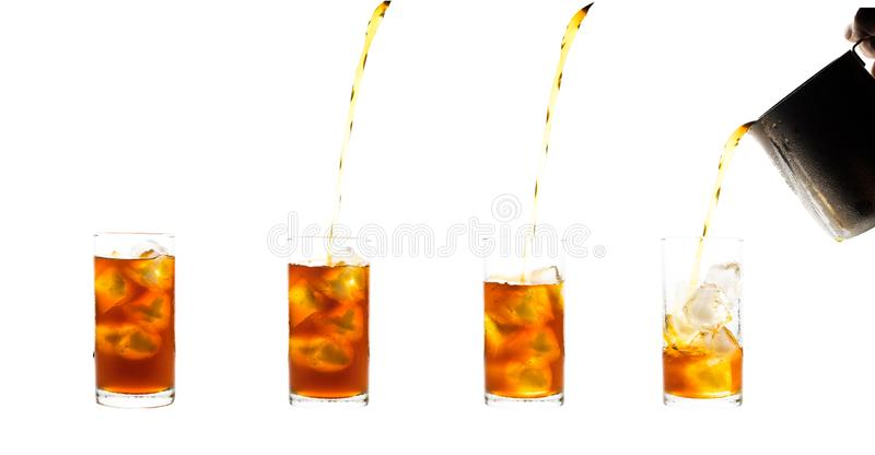 Coffee clod brew process (Method) by French press. Fill-pouring iced americano into a glass of water with iced. Isolated on white. Coffee clod brew process ( royalty free stock image