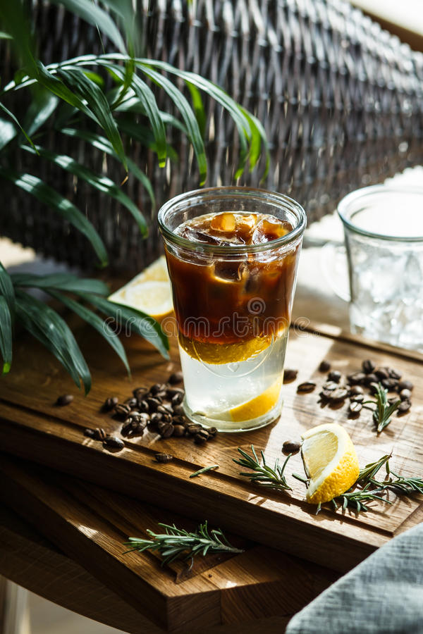 Coffee cocktail with lemon and tonic - vertical stock image