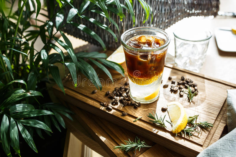 Coffee cocktail with lemon and tonic stock images