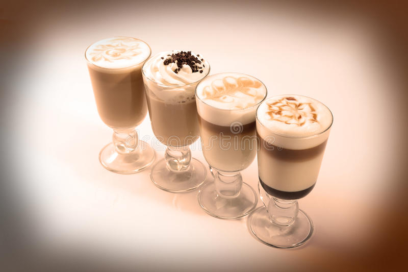 Coffee cocktails. Four coffee cocktails with whipped cream, vintage photo royalty free stock photos