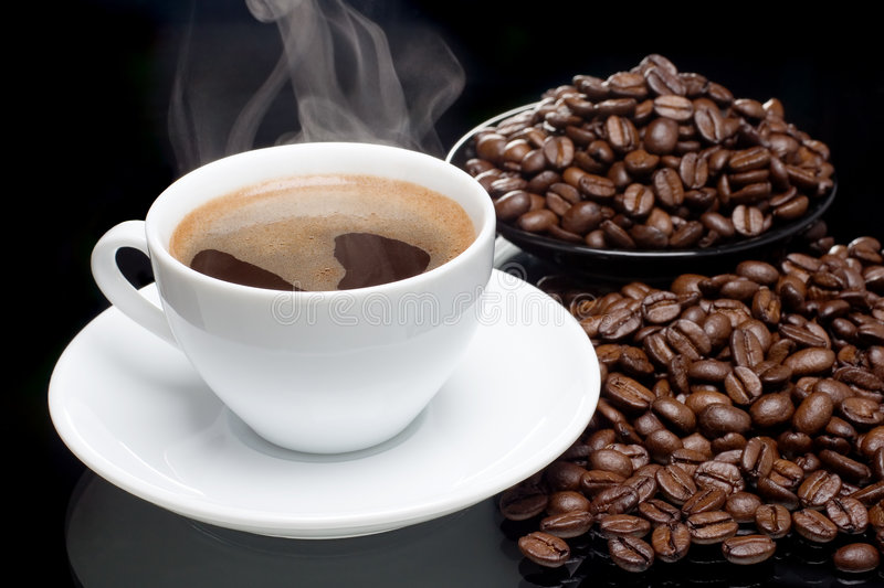 Coffee with coffee-beans stock image
