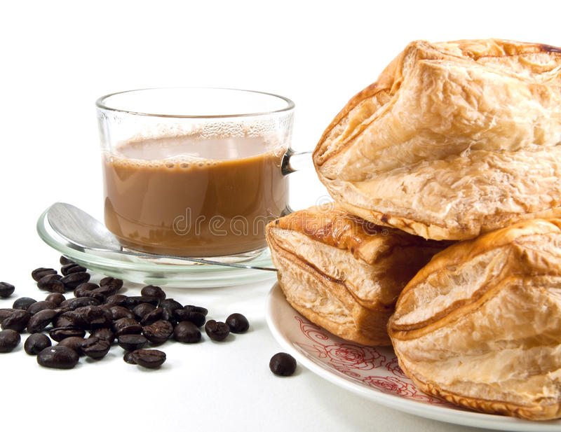 Coffee, coffee beans and pineapple puff. Breakfast conceptual royalty free stock images