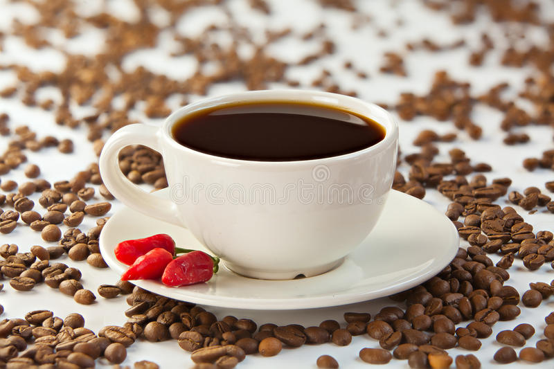 Coffee in coffee cup with natural grains royalty free stock photography