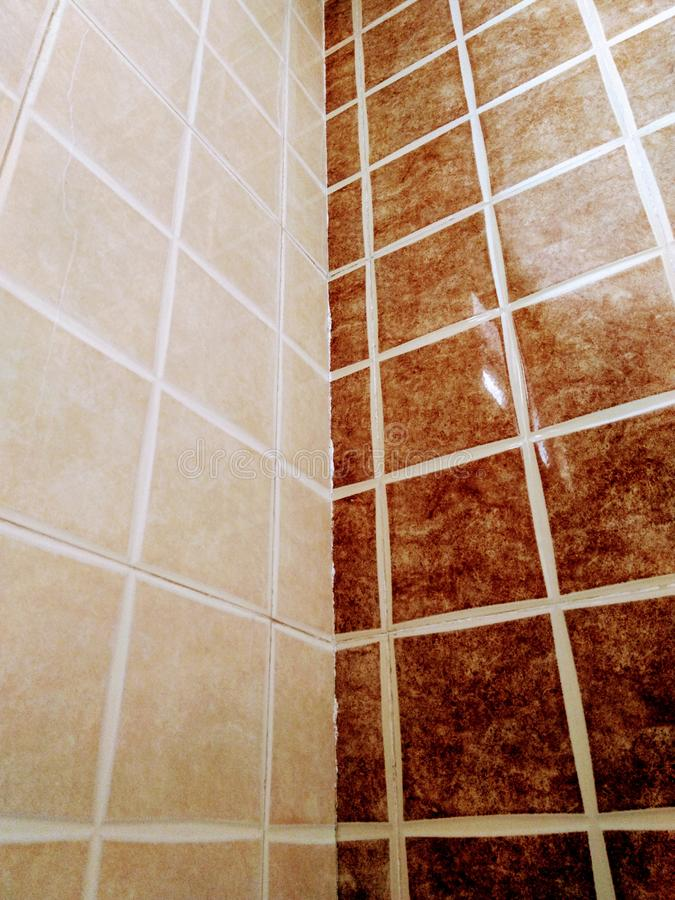 Coffee-colored bathroom wall tiles stock images