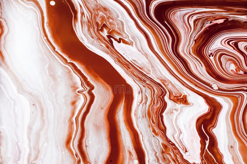 Coffee-colored marble texture with acrylic painted waves. Abstract painting background for wallpapers, posters, cards royalty free stock photo