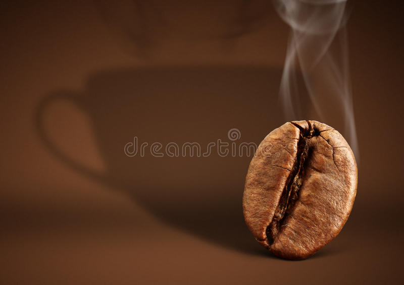 Coffee concept, bean with cup shadow on brown background stock photography