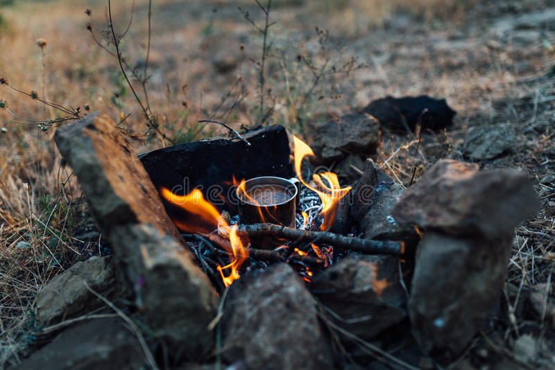 Coffee cooked over a campfire on nature stock images
