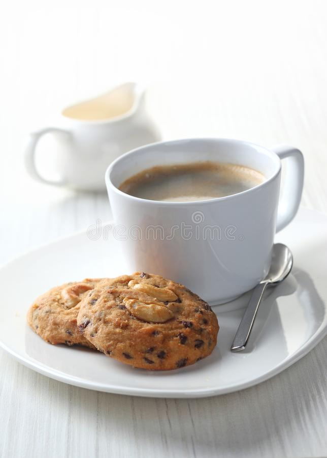 Coffee with cookies. Brewed coffee with cookies on linen royalty free stock image