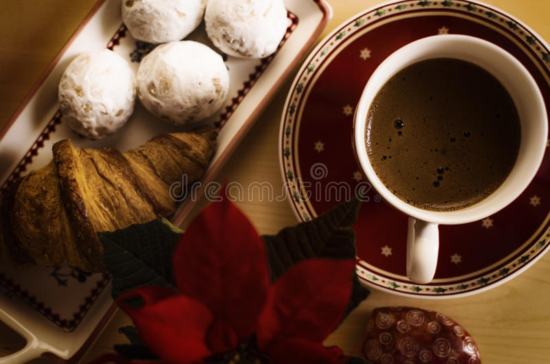 Coffee, cookies, one croissant and a Christmas flower royalty free stock image
