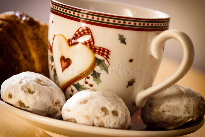Coffee, cookies, one croissant and a Christmas flower royalty free stock photo