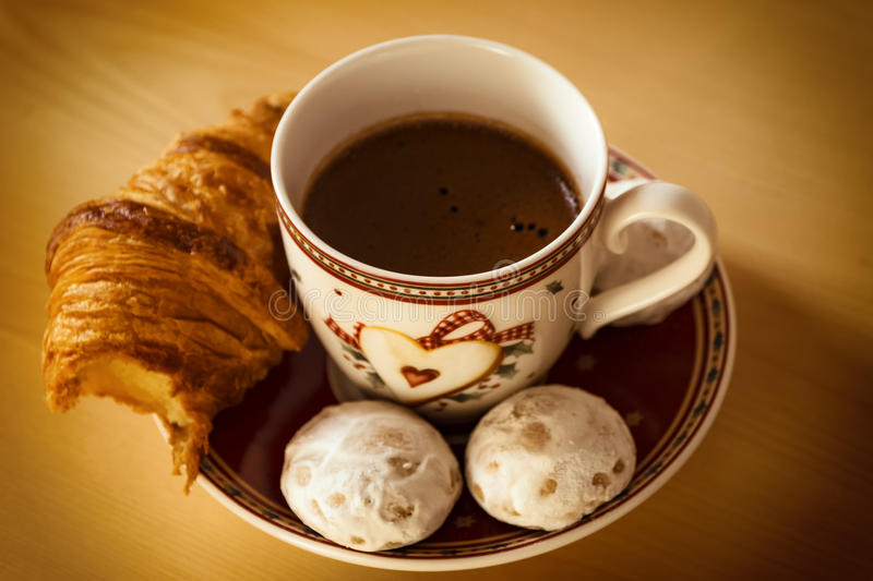 Coffee, cookies, one croissant and a Christmas flower stock images
