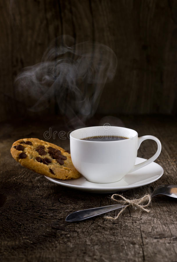 Coffee and cookies on the wooden table stock photo