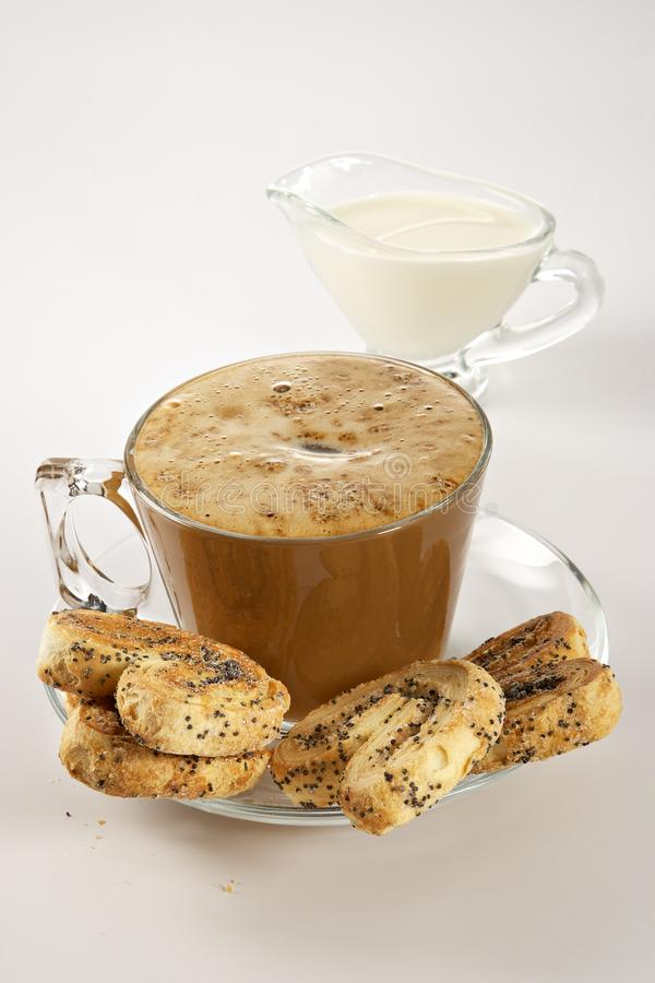 Coffee with cream and cookies stock photos