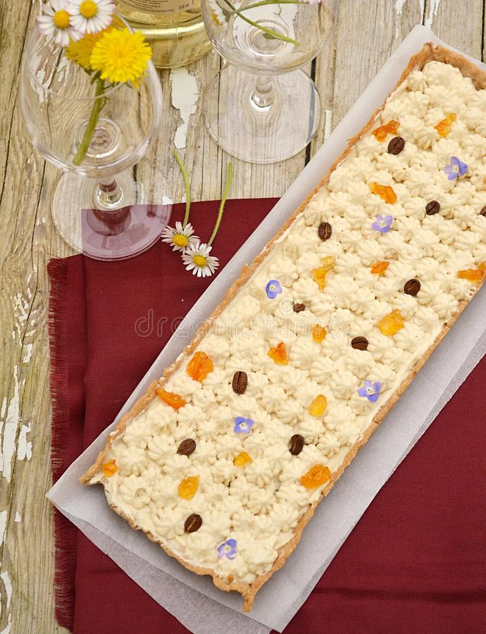 Coffee and cream sweet tart. With orange jam stock image