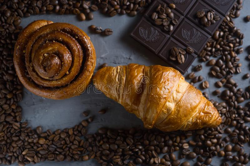 Coffee croissant chocolate breakfast arranged on a gray stone background top view. Photo in a low key royalty free stock image