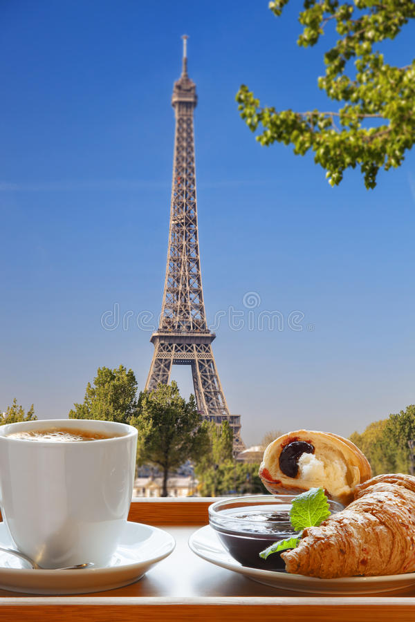Coffee with croissants against Eiffel Tower in Paris, France. Coffee with croissants against famous Eiffel Tower in Paris, France stock photo
