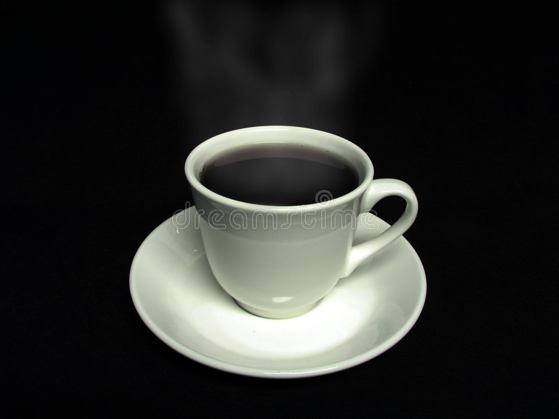 Coffee cup. Steaming brew of coffe with a cup and saucer royalty free stock images