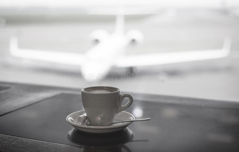 Coffee cup on airport background stock photos