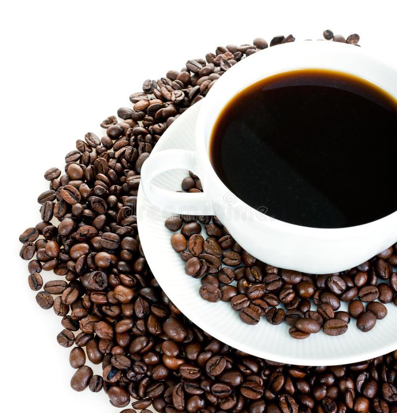 Coffee cup on beans stock photos