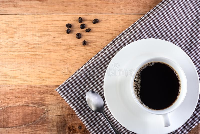 Coffee cup and beans. On wooden background royalty free stock photography