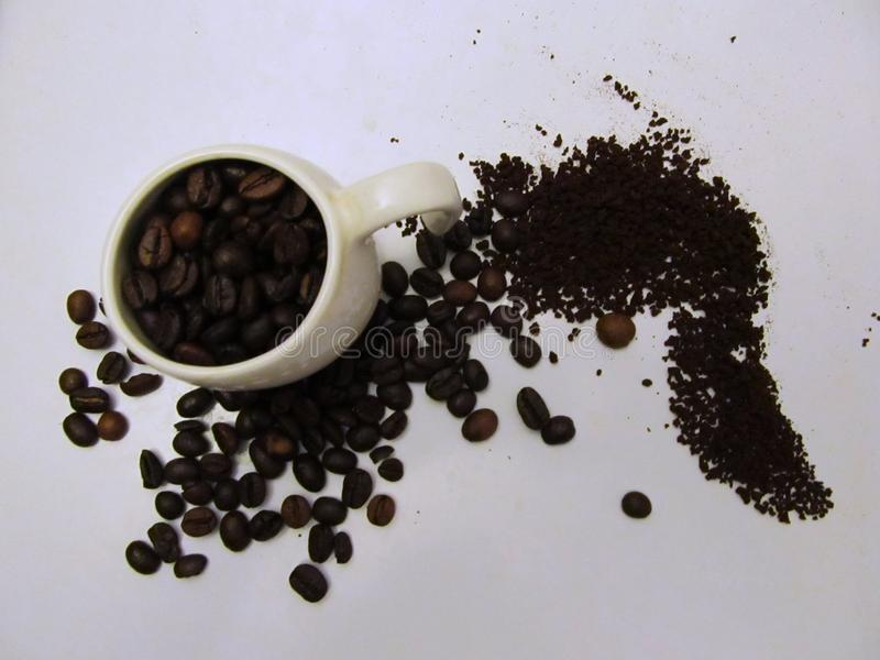 Coffee cup with coffee beans stock image