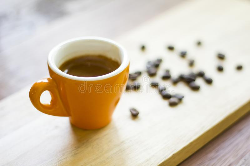 Coffee cup and coffee beans on wood stock images