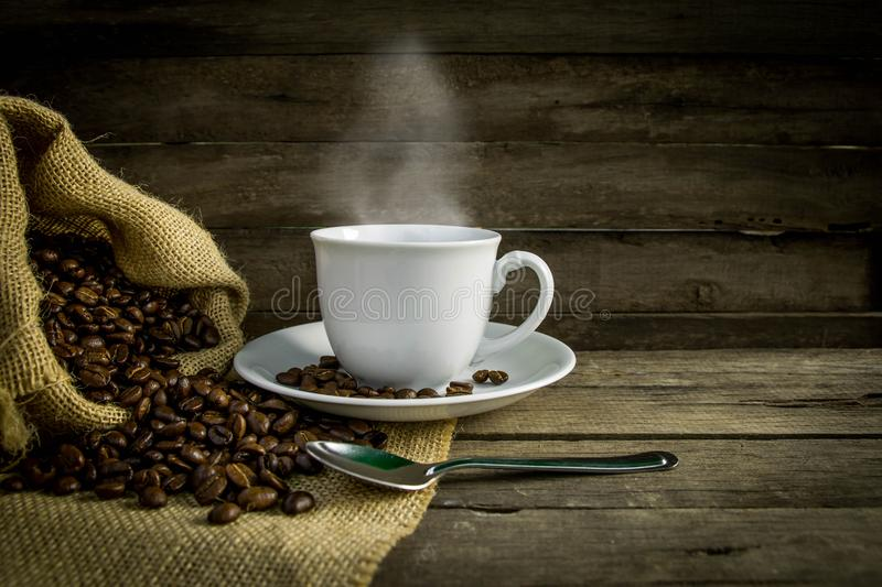 Coffee cup coffee beans royalty free stock photos