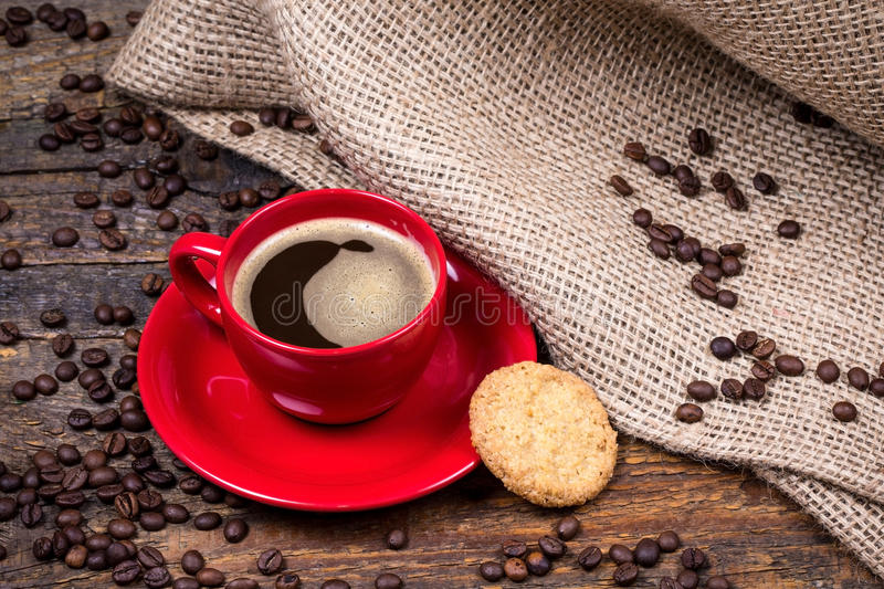 Coffee cup with biscuit and gunny textile royalty free stock photo