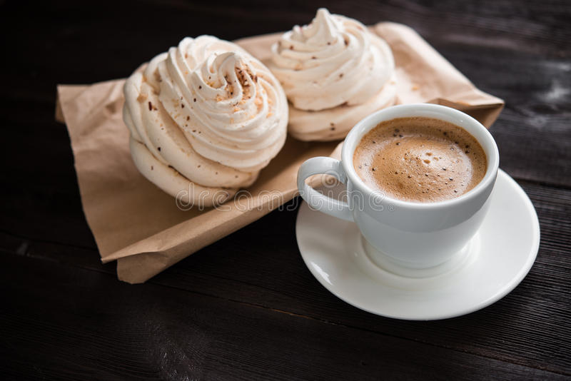 Coffee cup and bizet cake. On wood table background stock photos